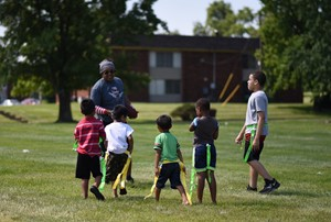 "Forest Park Assistant Fire Chief Jermaine Hill playing flag football with students at the Winton Woods City Schools ""Nutrition is the Mission"" Football Finale. Photo by Corina Denny."
