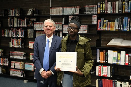 PHOTO CAPTION: Kiwanis Student of the Month Amy Gueye with board member Dr. John Cuppoletti. Photo by Drew Jackson.