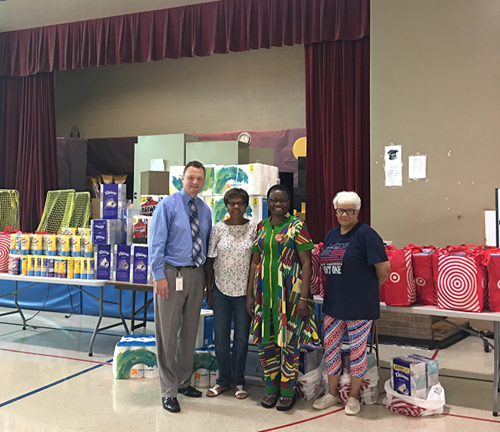 Members of Forest Chapel Church's Back-to-School Project stopped at WWPN to deliver school and classroom supplies.