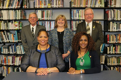 Winton Woods Board of Education President Dr. Viola Johnson (seated left) and Vice-President Katrina Rugless are shown with members (standing, l-r) Dr. John Cuppoletti. Paula Kuhn and Jeff Berte.