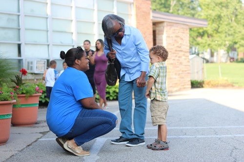 (left to right): Winton Woods Primary North Teacher Shawna Johnson greets former student Ona Zone and grandmother Beverly Zone.