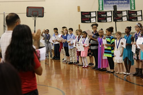 Winton Woods Elementary School students receive a standing ovation after being inducted into the National Elementary Honor Society.  Photo by Drew Jackson.