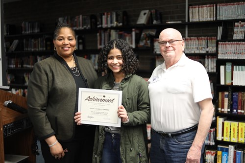 (l-r) Board President Dr. Viola Johnson, Kiwanis Student of the Month award winner Janny Castro Gutierrez and Kiwanis Club President Ji Hadley at January's board meeting.