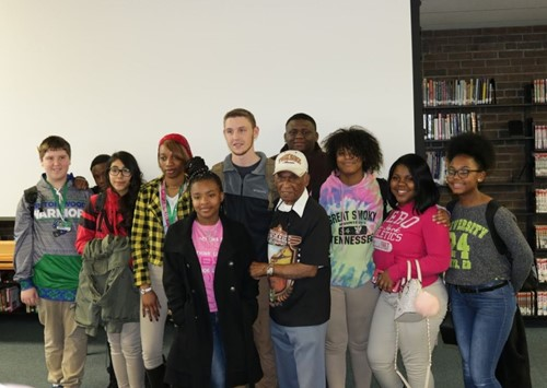 A group of Winton Woods High School students take picture with Les Edwards after speaking event. Photo by Drew Jackson.