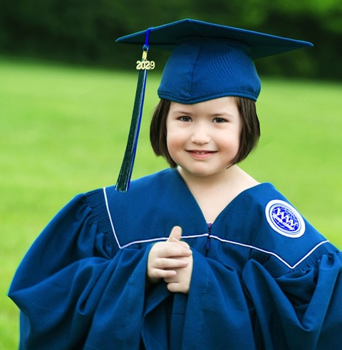 Preschool student in graduation gear