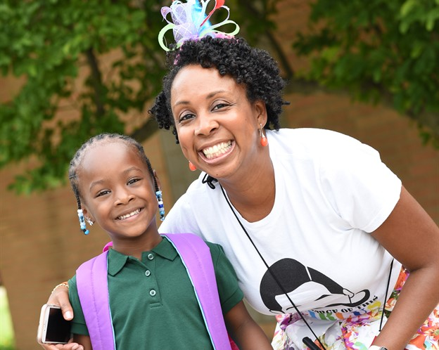 Principal Wallace and student on first day of schools