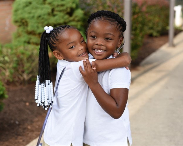 Sisters  at First Day of School