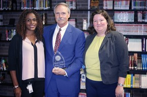 Tom Urban received the Winton Woods City Schools' August Community Spirit Award. Board members Jessica Miranda and Katrina Rugless can also be seen in the picture. Photo by Drew Jackson.