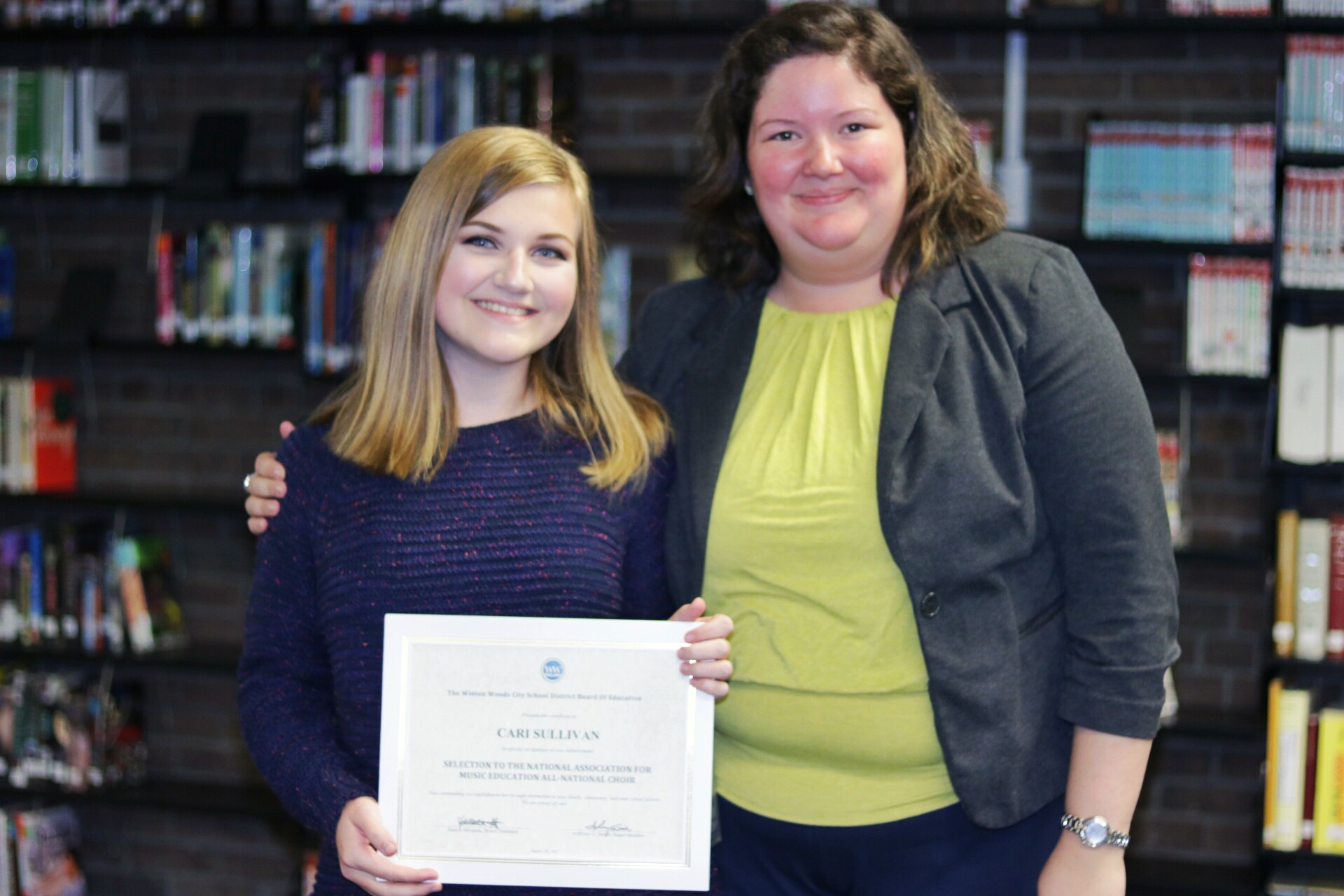 Winton Woods High School student Cari Sullivan shown with Board President Jessica Miranda after being honored at August Board meeting.