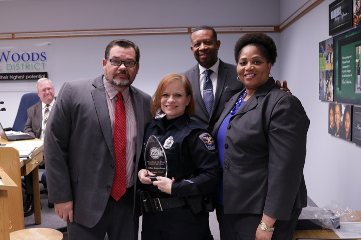 Officer Rebecca Eavers is shown with Lieutenant James Ward, Superintendent Anthony G. Smith and Winton Woods Board Vice President Dr. Viola Johnson. Photo by Drew Jackson.