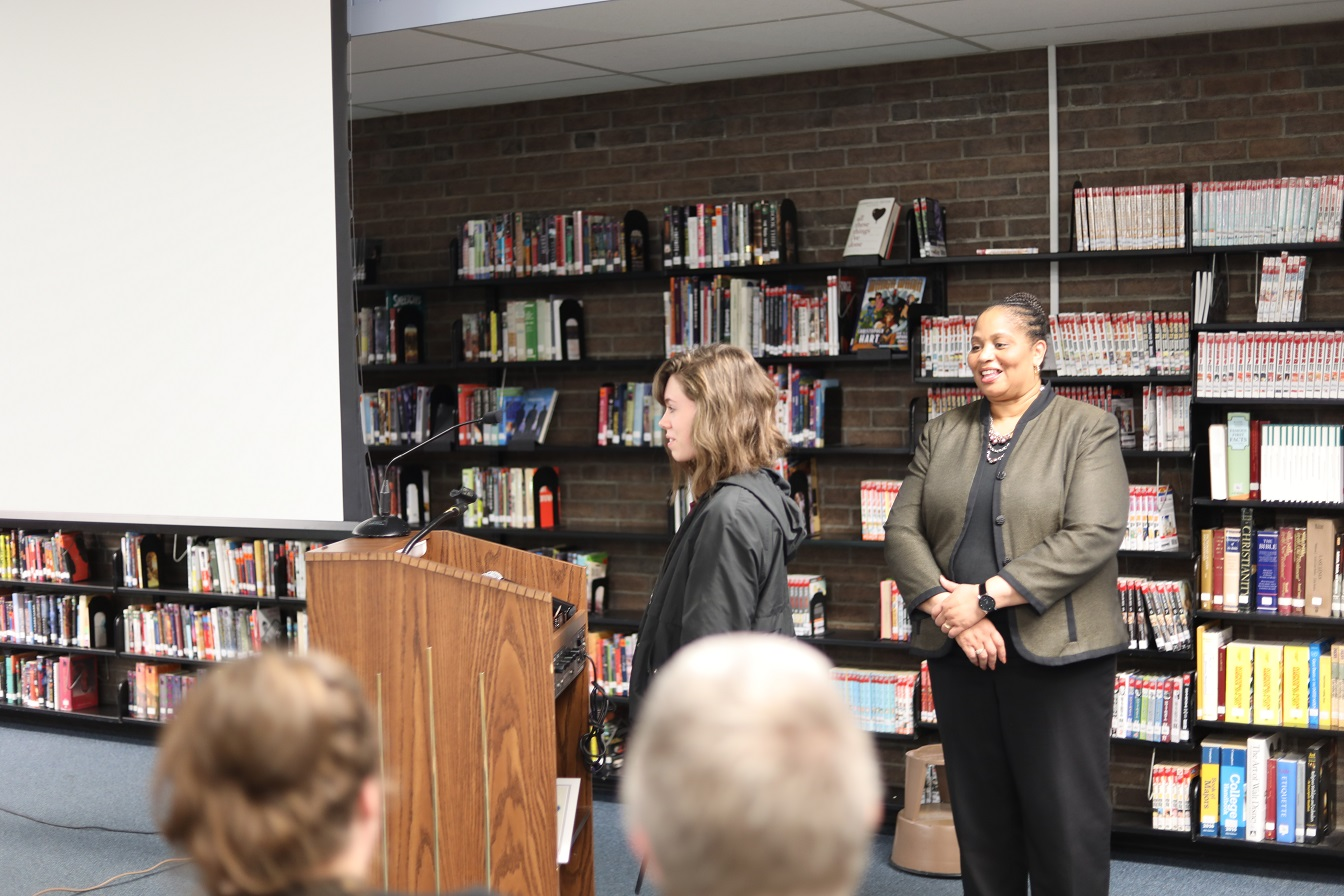 (l-r) is Skyline Student Athlete of the Month Riley Lauchard speaking after receiving her award at the January board meeting with Board President Dr. Viola Johnson.