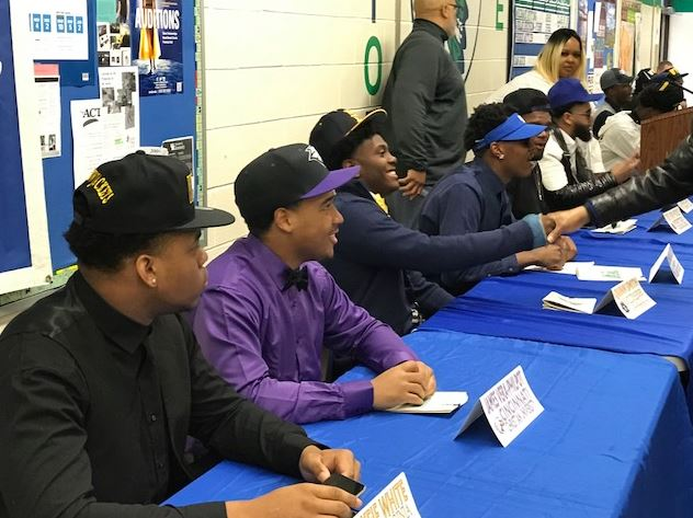 Student athletes greet and take pictures at Winton Woods High School's National Signing Day ceremony. Photo by Linda Schiltz.