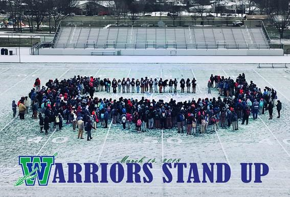 Winton Woods High School students and members of the community at the 17-minute ceremony at Charlie Fredrick Stadium to honor members of Marjory Stoneman Douglas High School. Photo by Drew Jackson.