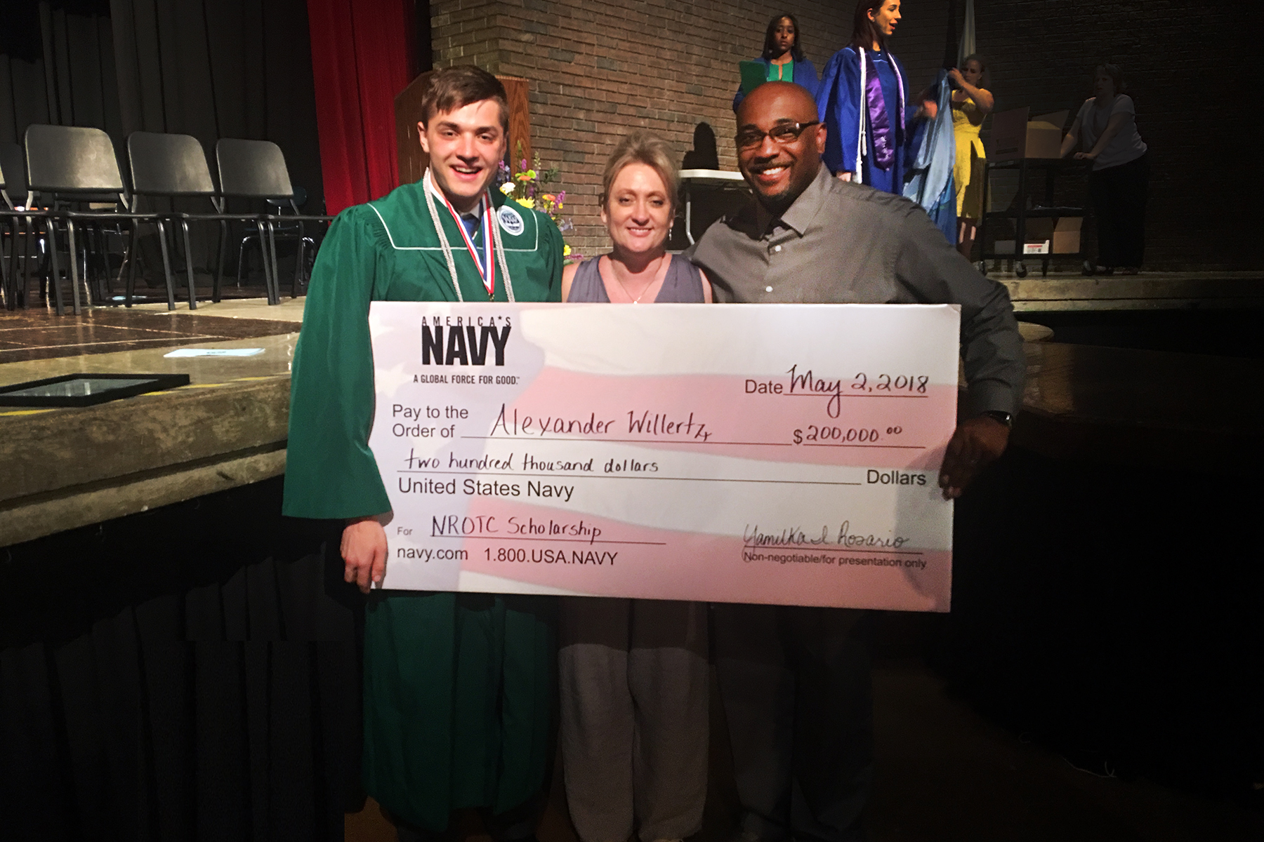 Winton Woods High School senior Alexander Willertz, his mother and Eric Martin, Principal of WWHS are shown with Willertz $200,000 check from the Navy Naval Reserve Officer Training Corps scholarship.