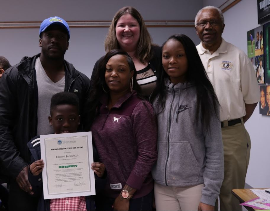 Edwards Jackson Jr. is shown with Board President Jessica Miranda, family and Greenhills-Forest Park Kiwanis Club Member. Photo by Drew Jackson.