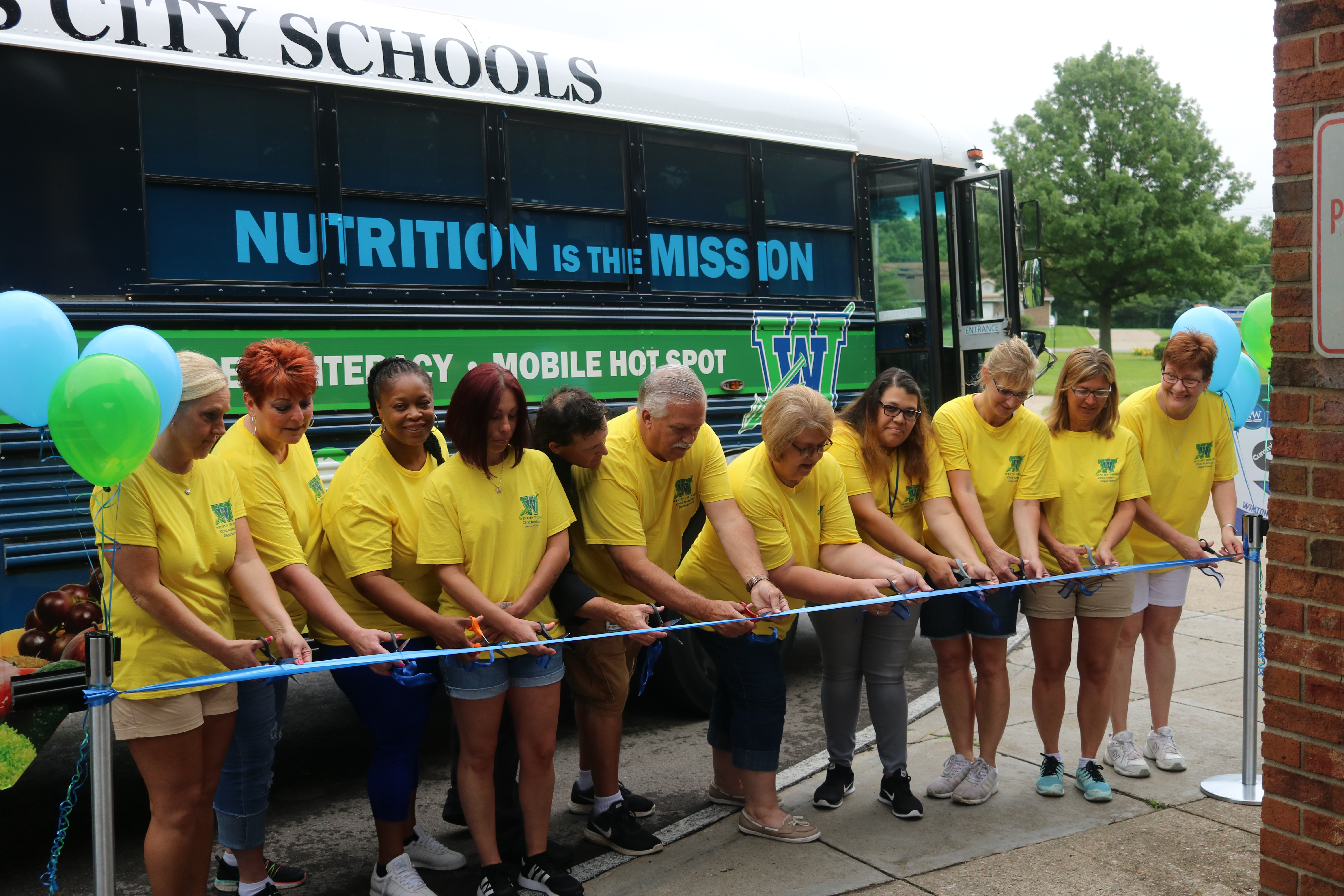 The Child Nutrition Department cutting the ribbon together at the ceremony. Photo by Drew Jackson.