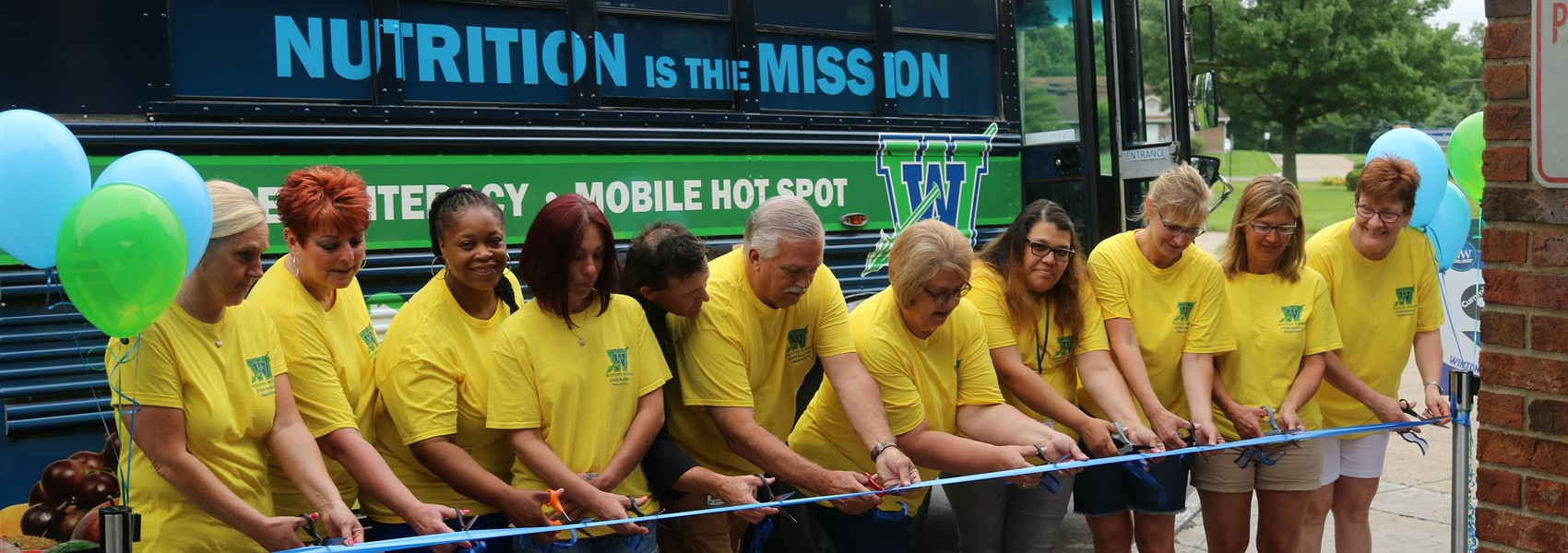 "Ribbon Cutting ceremony for the ""Nutrition is the Mission"" food bus."